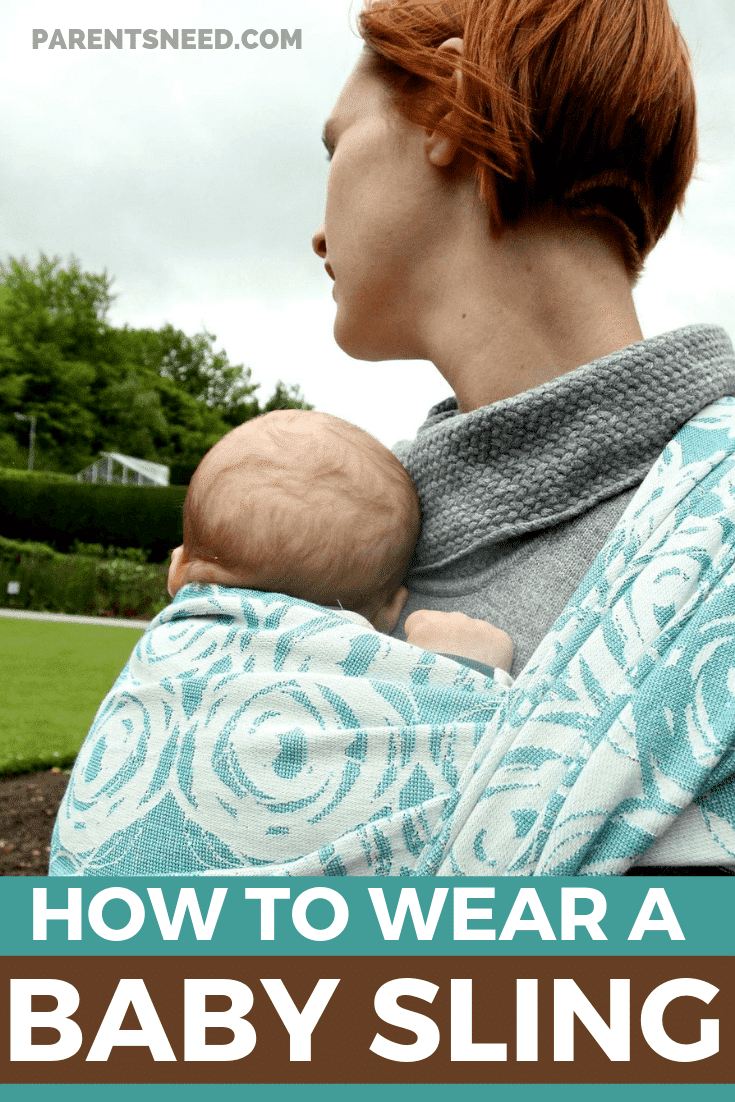 Woman carrying her child in a baby sling.
