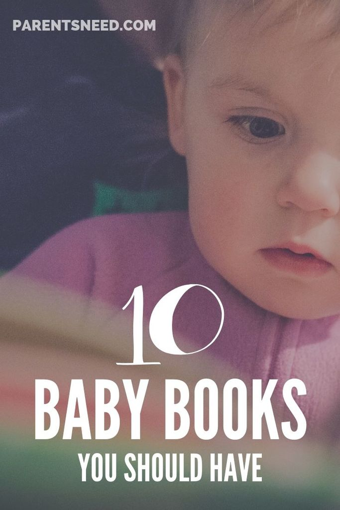 Baby mesmerized by a book.