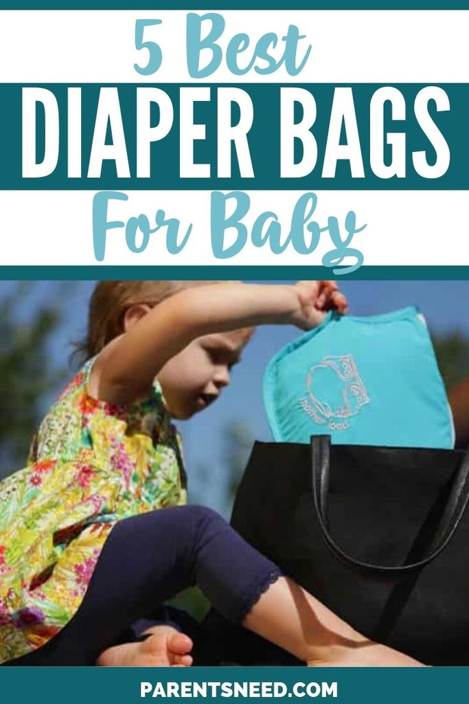 A baby pulling out a diaper bag.