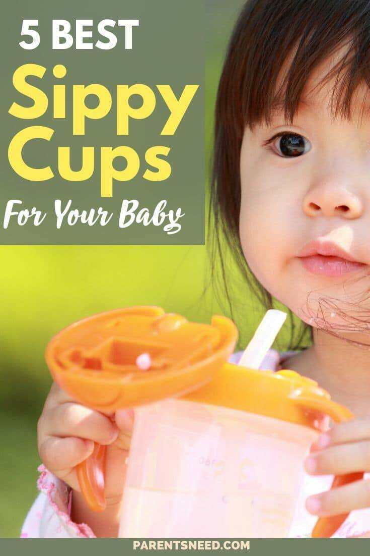 A cute toddler holding a sippy cup