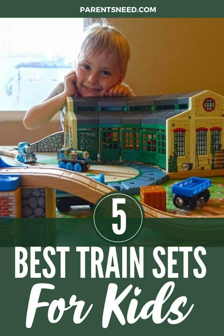a child happy with his trainset creation
