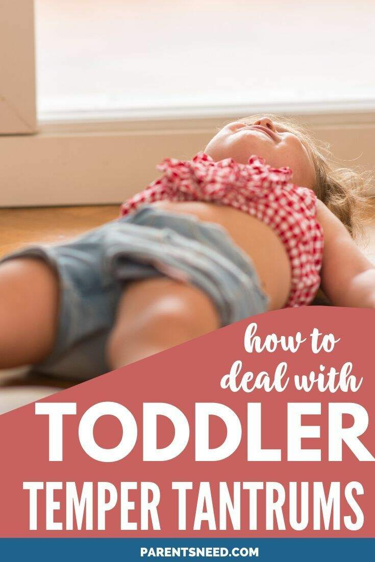 A toddler throwing a tantrum on the floor