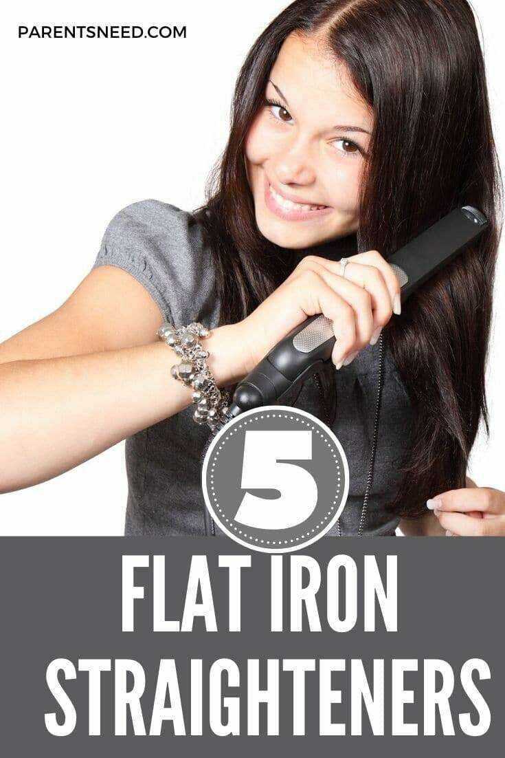 woman using flat iron to straighten her hair
